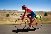 Cyclist on Highway 6 near Route 139, S.W. Colorado. USA.