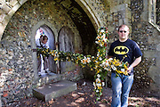 Little Walsingham, Norfolk, England, 08/04/2007..Roman Catholic pilgrims carry crosses wreathed in flowers into Walsingham Abbey on Easter Sunday. Pilgrims of various Christian denominations on Easter Saturday at one of Britain's oldest and most important centres of pilgrimage..