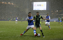 Sheffield Wednesday's Morgan Fox and Carlisle united's Mike Jones battle for the ball