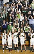John A. Coleman girls' basketball players show the Section 9 Class D championship plaque to their fans after defeating Eldred at Mount Saint Mary College in Newburgh on March 5, 2010.