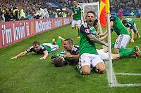 GOAL CELEBRATION - Northern Ireland's Gareth McAuley celebrates scoring the opening goal with team mates<br /> <br /> Photographer Craig Mercer/CameraSport<br /> <br /> International Football - 2016 UEFA European Championship - Group C, Ukraine v Northern Ireland - Thursday, 16th June 2016 - Stade de Lyon, Lyon, France<br /> <br /> World Copyright © 2016 CameraSport. All rights reserved. 43 Linden Ave. Countesthorpe. Leicester. England. LE8 5PG - Tel: +44 (0) 116 277 4147 - admin@camerasport.com - www.camerasport.com