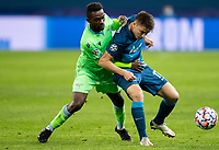 SAINT PETERSBURG, RUSSIA - NOVEMBER 04: Jean-Daniel Akpa Akpro of SS Lazio tussles with Andrei Mostovoy of Zenit St Petersburg during the UEFA Champions League Group F stage match between Zenit St. Petersburg and SS Lazio at Gazprom Arena on November 4, 2020 in Saint Petersburg, Russia. (Photo by MB Media)