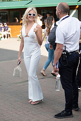 © Licensed to London News Pictures. 12/07/2019. London, UK. Pixie Lott walks around the grounds on Day 11 of the Wimbledon Tennis Championships 2019 held at the All England Lawn Tennis and Croquet Club. Photo credit: Ray Tang/LNP