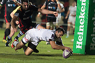 Thomas Laranjeira of Brive slips past Charlie Davies of the Newport Gwent Dragons to score the fist try for Brive. European Challenge cup pool 3 match, Newport Gwent Dragons v Brive, at Rodney Parade in Newport, South Wales on Friday 14th October 2016.<br /> pic by  Simon Latham, Andrew Orchard sports photography.