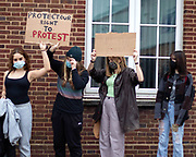 """The Protest stops at Alex Chalk's offices, Cheltenham's MP. The protests stay socially distanced as they continue to chant """"Kill the bill""""."""