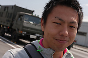 Kohei Yokoyama, from Osaka, aged 32 is a volunteer in the tsunami clean up at a convenience store just outside the police roadblock to reinforce the nuclear contamination area 20 kilometres from the tsunami damaged Fukushima Daichi nuclear power station near Minami Soma, Fukushima, Japan. Wednesday May 4th 2011