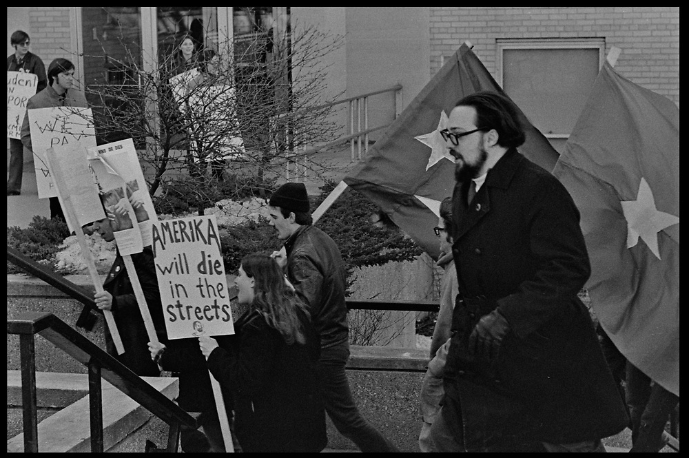 Madison, WI - March 1970. On March 15, 1970, the University of Wisconsin - Madison Teaching Assistants' Association voted to strike, and the campus was filled with picket lines as well as demonstrations of related and other issues. The strike lasted until early April, when the Association and Univeristy came to an agreement. Potesters carry Cuban flags, and signs in support of Che Guevara near Birge Hall.