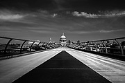 EDITORS NOTE: Image has been converted to black and white. Londons deserted Millenium Bridge leading to St Pauls Cathedral deserted and on lockdown as a result of the Coronavirus Pandemic on 16th April 2020 in London, United Kingdom. Coronavirus or Covid-19 is a new respiratory illness that has not previously been seen in humans. Much of Europe has been placed into lockdown, with stringent rules in place as part of a long term strategy, and in particular social distancing, and a stay at home policy.