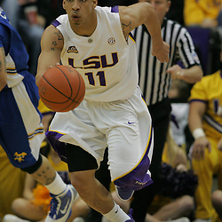 Jan 04, 2010; Baton Rouge, LA, USA;  LSU Tigers guard Bo Spencer (11) drives with the ball during a game against the McNeese State Cowboys at the Pete Maravich Assembly Center. LSU defeated McNeese State 83-60.  Mandatory Credit: Derick E. Hingle-US PRESSWIRE