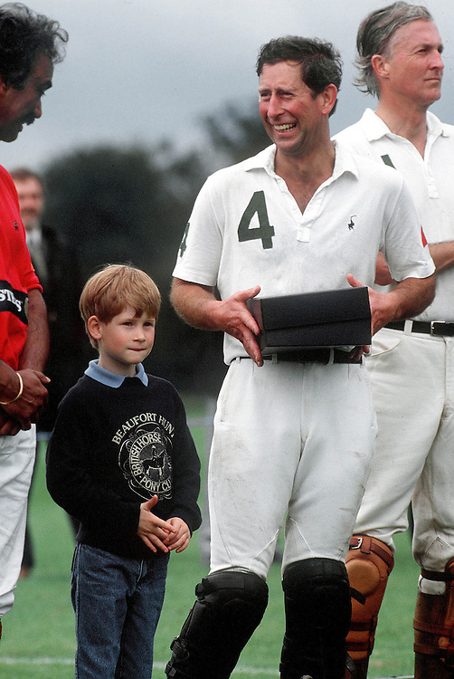 Prince Charles the Prince of Wales with his son Prince Harry seen at a charity polo match in Cirencester, UK. Photograph by Jayne Fincher