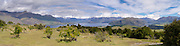 Panoramic view from atop Mt. Irons, above Wanaka; looking SW;  Mt. Aspiring National Park is in the distance.