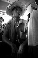Portrait of a man with his hat in a bus going to Yangshuo, guanxi, china