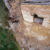An archaeologist climbs up to a rare unlooted pre-Incan tomb.