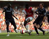 Photo: Tony Oudot.<br /> Arsenal v Bolton Wanderers. The Barclays Premiership. 14/04/2007.<br /> Emmanuel Adebayor of Arsenal breaks through the Bolton defence