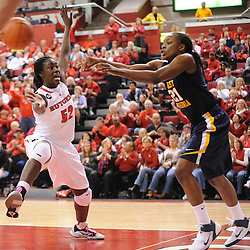 Rutgers Scarlet Knights forward Chelsey Lee (52) pressures West Virginia Mountaineers guard/forward Korinne Campbell (21) on an inbound play during second half Big East NCAA women's basketball action during Rutgers' 67-58 victory over West Virginia at the Louis Brown Rutgers Athletic Center.