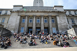 © Licensed to London News Pictures. 04/05/2016. Leeds, UK. Students enjoy the bright warm sunshine on the steps of Leeds University in West Yorkshire. Britain is experience warmer weather this week with temperatures to rise to 23 degrees celsius this weekend. Photo credit : Ian Hinchliffe/LNP