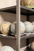 Globes in the storeroom at Bellerby and Co. Globemakers, Hackney, London, UK