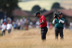 USA's Tiger Woods in the rough during day four of The Open Championship 2018 at Carnoustie Golf Links, Angus.