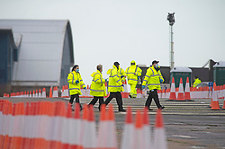 © Licensed to London News Pictures 23/12/2020.        Manston, UK. Medical staff walking to the trucks at the airport. The Army and NHS staff have arrived at Manston Airport to administer Covid-19 lateral flow tests to truckers who are stranded in Kent. Angry lorry drivers blockading local roads and clashed with police in Kent this morning. France have closed its borders to all freight traffic because of the new Coronavirus strain. Photo credit:Grant Falvey/LNP