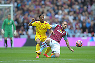 Raheem Sterling of Liverpool and Ron Vlaar of Aston Villa compete for the ball. The FA Cup, semi final match, Aston Villa v Liverpool at Wembley Stadium in London on Sunday 19th April 2015.<br /> pic by John Patrick Fletcher, Andrew Orchard sports photography.