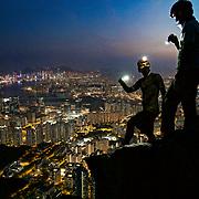 Members of Urbex, or Urban Explorers, explore Hong Kong's cityscape.