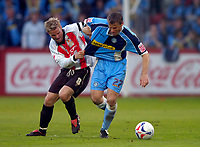 Photo: Richard Lane.<br />Cheltenham Town v Wycombe Wanderers. Coca Cola League 2. Play off Semi Final, 2nd Leg. 18/05/2006.<br />Wycombe's Rob Lee is challenged by John Finnigan.
