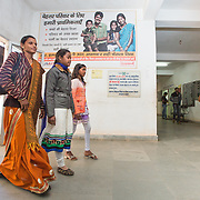 CAPTION: Sahiya Anupa Devi brings two girls from her area to the ARSH clinic. Whenever adolescents come to their sahiyas with concerns that they themselves cannot solve, they are encouraged to bring them to this facility. LOCATION: Adolescent Reproductive and Sexual Health (ARSH) clinic, Ratu Community Health Centre (CHC), Ranchi (city), Jharkhand (state), India. INDIVIDUAL(S) PHOTOGRAPHED: From left to right: Anupa Devi, Shakuntala Kumari and Dipika Kumari.