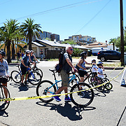 Cyclovia Tucson participants are serenaded by a front yard guitarist while they wait to cross Euclid Avenue.
