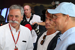 Chief Executive Officer of the Formula One Group Chase Carey (left) and Actor and Director Woody Harrelson (right)during the 2017 British Grand Prix at Silverstone Circuit, Towcester.
