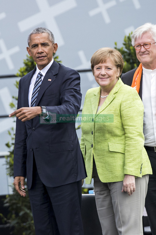 May 25, 2017 - Berlin, Germany - Former US President Barack Obama (L) and German Chancellor Angela Merkel (R) leave after  attending a panel discussion about democracy at the Protestant Kirchentag (Church Day) in Berlin, Germany on May 25, 2017. (Credit Image: © Emmanuele Contini/NurPhoto via ZUMA Press)