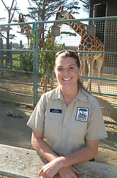 Sarah King of Walnut Creek, Calif., the primary giraffe keeper at the San Francisco Zoo, poses for a photograph with the reticulated giraffes Monday, Sept. 6, 2010 in San Francisco. (D. Ross Cameron/Staff)