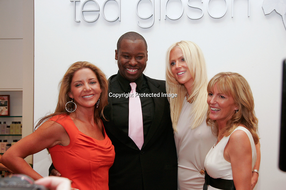 """090924-CHEVYCHASE-(L-R)Mary Amons, Tareq-Michaele Salahi, and Catherine Ommanney, casts member of the up and coming Bravo show """"The Real Housewives of DC,""""  pose for a photo with stylist Ted Gibson(2nd-L) during the grand opening of his new salon in Chevy Chase, Md on September 24, 2009."""