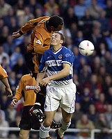 Copyright Sportsbeat. 0208 3926656<br />Picture: Henry Browne<br />Date: 14/05/2003<br />Reading v Wolverhampton Wanderers First Division play off semi final second leg<br />Darius Henderson of Reading is knocked off the ball in the Wolves area by Joleon Lescott