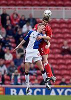 Photo. Glyn Thomas.<br /> Middlesbrough v Blackburn Rovers. Premiership. <br /> Riverside Stadium, Middlesbrough. 07/02/2004.<br /> Boro's Chris Riggott (R) fights an aerial battle for possession with John Stead.