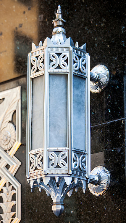 A splendid, Art Deco light fixture stands out against the black marble entrance to a Chase Bank branch on the Lexington Avenue facade of the Chrysler Building.