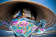Colorfully wrapped face of a worker in the Doc Let salines, Khanh Hoa Province, Vietnam, Southeast Asia