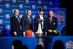 Florida Gators head coach Dan Mullen and Michigan Wolverines head coach Jim Harbaugh speak with the media at the coaches news conference on Friday, December 28, 2018 in Atlanta. Florida and Michigan face off in the Peach Bowl NCAA football game on December 29, 2018. (Jeannie Abell via Abell Images for the Chick-fil-A Peach Bowl)