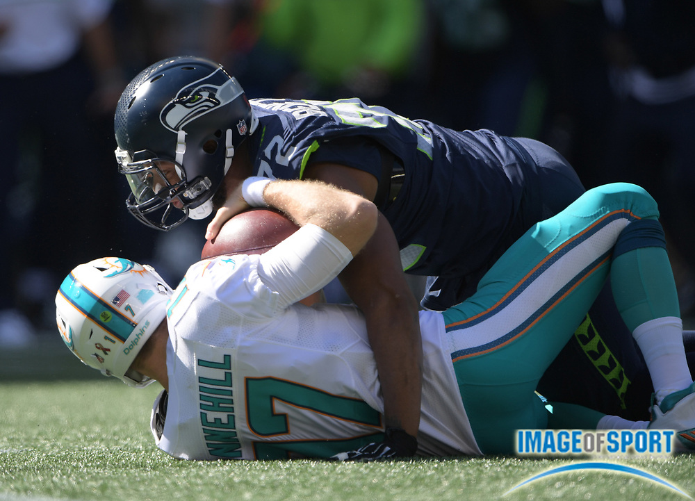 Sep 11, 2016; Seattle, WA, USA; Seattle Seahawks defensive end Michael Bennett (72) sacks Miami Dolphins quarterback Ryan Tannehill (17) during a NFL game at CenturyLink Field. The Seahawks defeated the Dolphins 12-10.