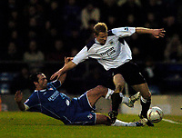 Fotball<br /> FA Cup England 2004/2005<br /> 3. runde<br /> 08.01.2005<br /> Foto: SBI/Digitalsport<br /> NORWAY ONLY<br /> <br /> Oldham Athletic v Manchester City<br /> <br /> Manchester City's Ben Thatcher (R) is tackled by Oldham's John Eyre