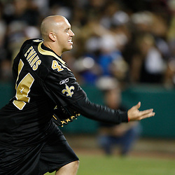 Apr 28, 2010; Metairie, LA, USA; Heath Evans (44) pitches during the Heath Evans Foundation charity softball featuring teammates of the Super Bowl XLIV Champion New Orleans Saints at Zephyrs Field.  Mandatory Credit: Derick E. Hingle-US-PRESSWIRE.