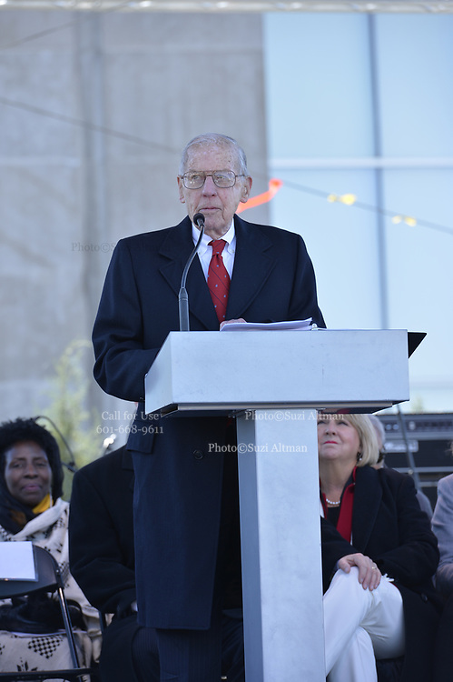 "Photo ©Suzi Altman 12/9/17 Jackson,MS President Trump made private remarks during the grand opening of the Civil Rights and History Museums in Jackson Mississippi. Trump spoke to a small private group of civil rights icons, museums directors, and other elected officials including MS. Governor Bryant in the auditorium after his brief tour of the museum. Trump said ""the Civil Rights Museum is a tribute to our nation and to the State of Mississippi "" and he paid tribute to other leaders of the civil rights movement including James Meredith and Medgar Evers . Trumps appearance was controversial to many residents of the state of Mississippi and protests were scattered around the museums exterior.   Myrlie Evers- William widow of slain civil rights icon Medgar Evers attended the opening of the Mississippi Civiil Rights and History Museums. Evers spoke to the crowd outside after President Trump made private remarks inside to a closed audience of invited guests and press only. <br />  Right before the ribbon cutting ceremony outside on the podium Mrs Evers said "" These museums are priceless, going through the museum of my history I felt the bullets and the fears, but I also felt the hope."" President Trump had a very short private tour of the Civil Rights Museum and did not mingle outside or stop to talk with any visitors to the new Civil Rights  museum. Photo©SuziAltman"