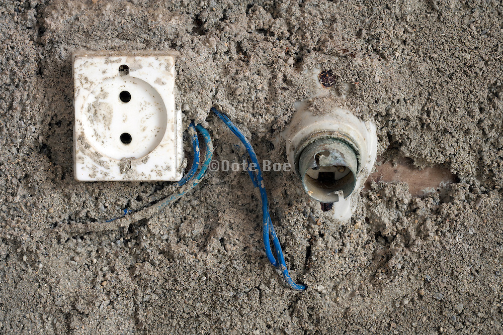 dangerous looking wall outlet with light fixture