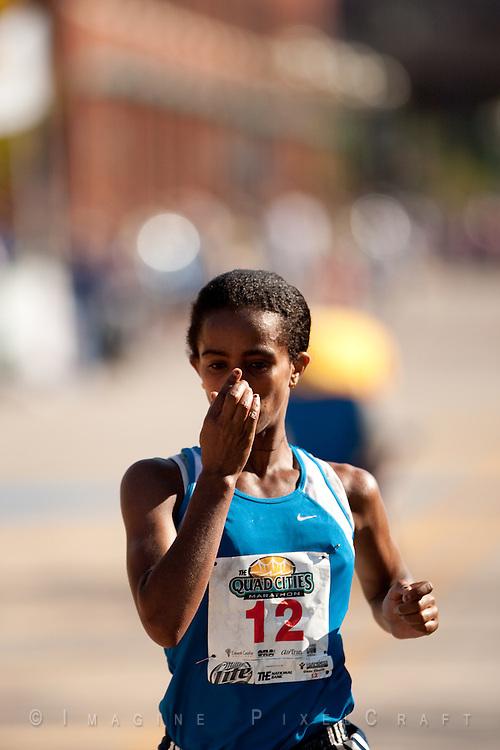 Buzunesh Deba gives thanks as the wins the Quad Cities Marathon 2009 women's division.