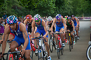 London, UK. Tuesday 7th August 2012. Men's Triathlon held in Hyde Park. Competing athletes take part in the cycle section of the race.