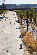 Over 700 school children attended the River School Day clean up of the LA River sponsered by FoLAR (Friends of the Los Angeles River), Glendale Narrows, Los Angeles, California, USA