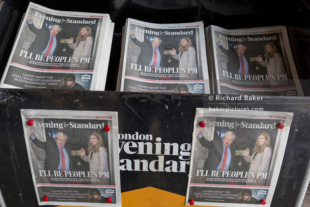 "The day after UK Prime Minister Boris Johnson's Conservative Party won a landslide general election victory, winning a majority of 80 parliamentary seats (the largest since 1987), the Evening Standard newspaper shows Johnson and his partner Carrie Symonds waving on the steps of 10 Downing Street above the headline ""I'll Be The People's PM"", on 13th December 2019, in London, England."