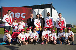 Commonwealth athletes with Chair of Birmingham 2022 John Crabtree Chair of Birmingham 2022 (centre left), MD for Venues at the NEC Phil Mead (centre right) with children from Mapledene Primary School line up during the photocall for the Birmingham 2022 Commonwealth Games sports and venues announcement at the National Exhibition Centre.