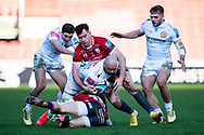 Olly Woodburn of Exeter Chiefs is tackled by Mark Atkinson of Gloucester Rugby during the Gallagher Premiership Rugby match between Gloucester Rugby and Exeter Chiefs at the Kingsholm Stadium, Gloucester, United Kingdom on 26 March 2021.