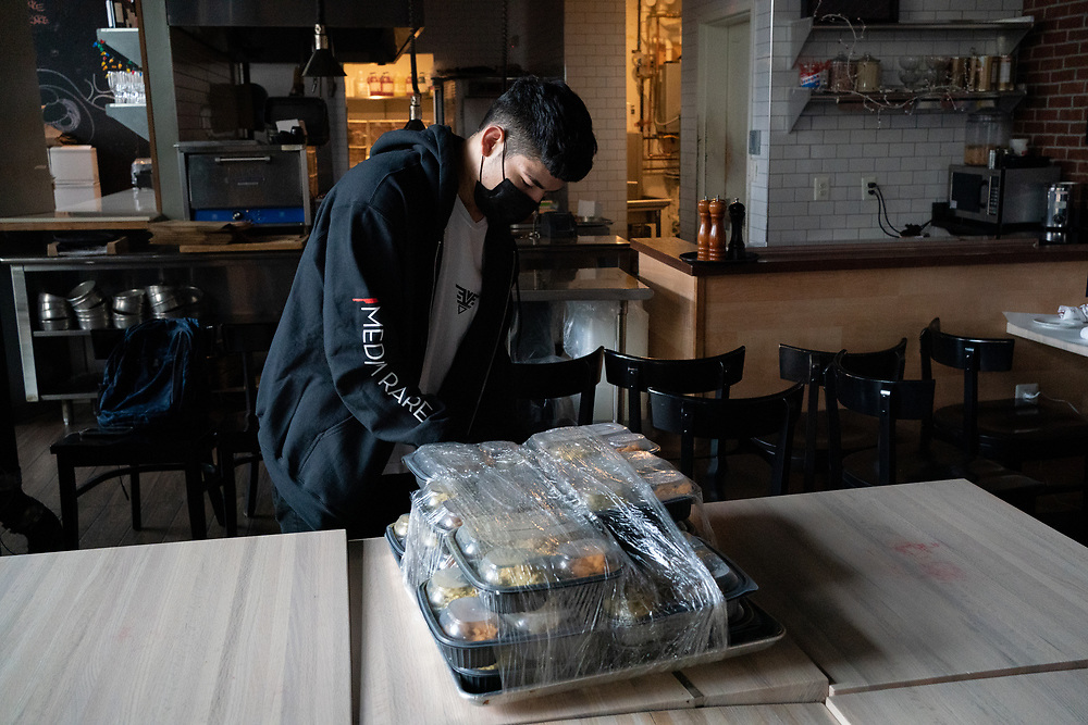 Emerson Zuniga, 19, prepares Thanksgiving meals for delivery at Medium Rare in Bethesda, MD on Wednesday, November 25th, 2020. Medium Rare chef and owner Mark Bucher runs several free meal initiatives across DC and Maryland.