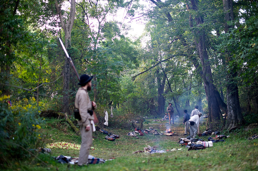 A Confederate sentry guards the entrance to his company's campsite during the 150th Antietam Civil War Reenactment.